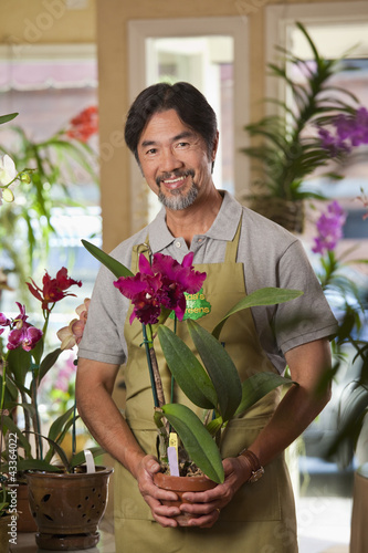 Japanese florist holding exotic flower