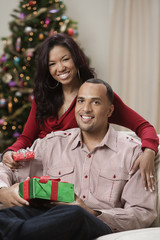Couple sitting together with Christmas gifts