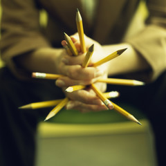 Close up of Caucasian businesswoman's hands holding pencils