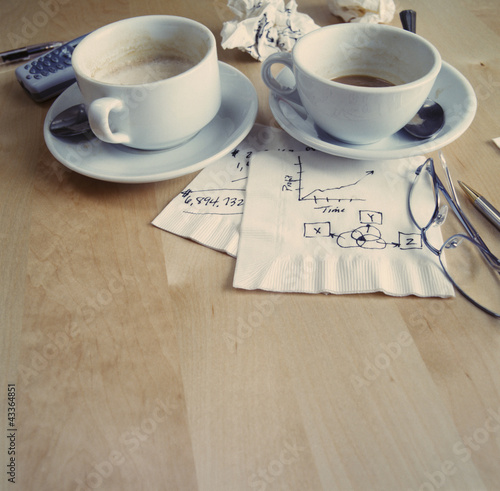 Coffee cups and drawings on napkins