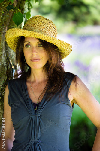 Beautiful Woman under the shade of a tree