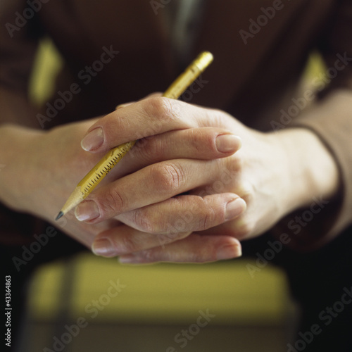 Close up of Caucasian businesswoman's hands holding pencil