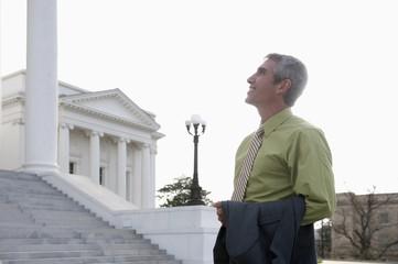 Caucasian businessman standing near steps