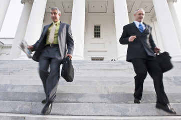 Businessmen walking down steps