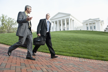 Businessman walking together on walkway