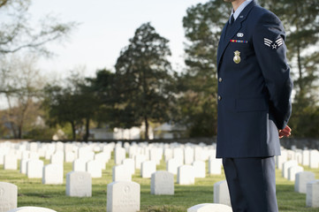 Caucasian soldier visiting cemetery