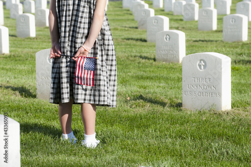 Caucasian girl with flat visiting cemetery