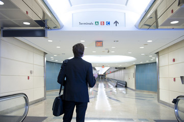Caucasian businessman standing in airport