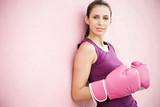 Hispanic woman in boxing gloves