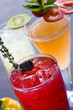 Collection of iced alcoholic beverages with garnishes