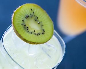 Iced lime beverage with Kiwi fruit garnish