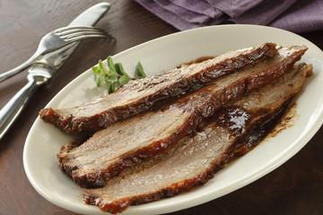 Beef brisket served on plate