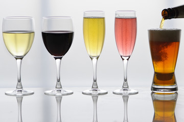 Selection of wines and a beer in glasses