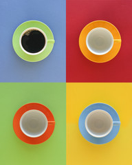 Modern, geometric array of four cups, one filled with coffee