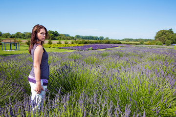 Beautiful Woman in a field of purple lavender