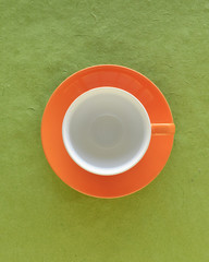 Empty coffee cup and saucer, top view