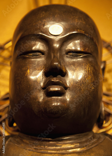 Close up of golden Buddha statue