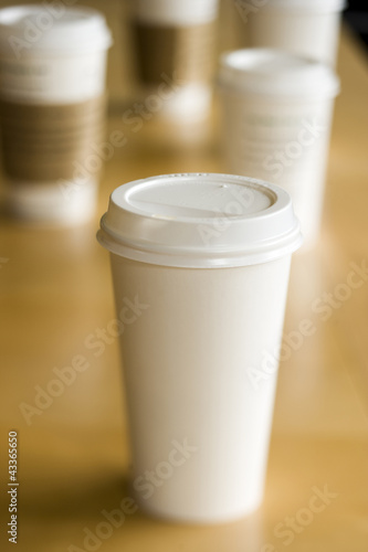 Row of disposable coffee cups