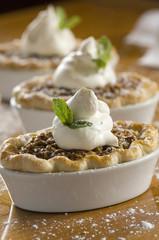 Row of single-serving pecan pies