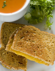 Grilled cheese sandwich served with cup of soup