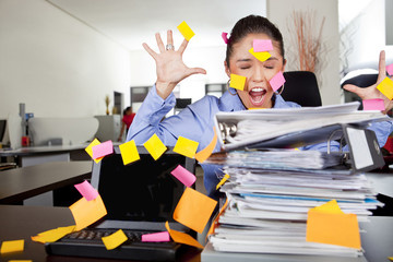 Hispanic businesswoman covered in sticky notes