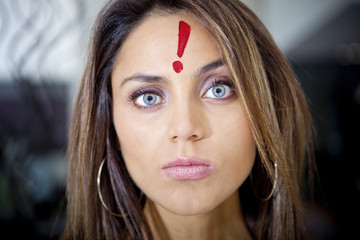 Hispanic woman with exclamation mark on her forehead