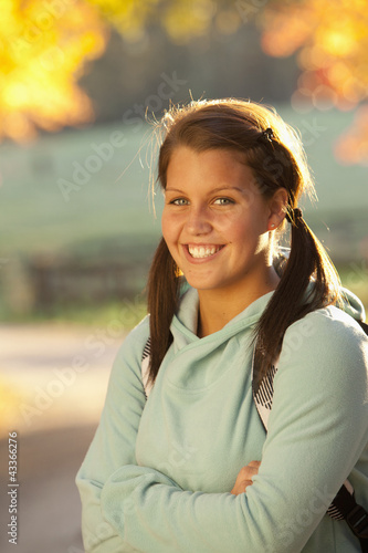 Smiling Caucasian teenager standing outdoors