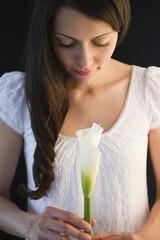 Brazilian woman holding calla lily