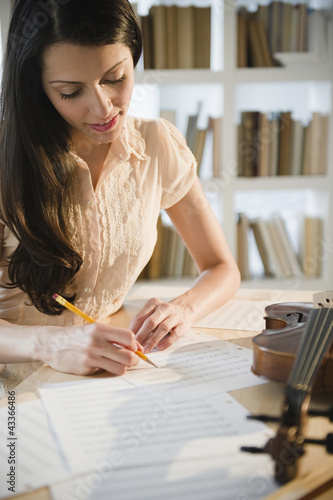 Brazilian woman writing music