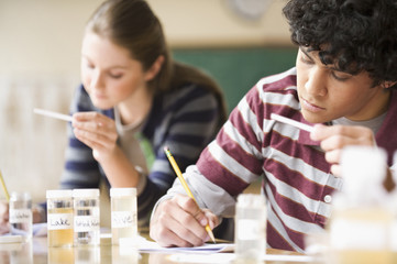 Teenage students studying in laboratory