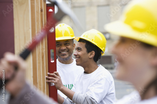 Volunteers working on construction site