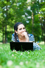 Beautiful young woman  using her laptop outdoors