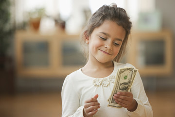 Mixed race girl counting money