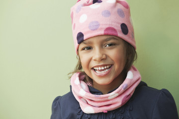 Mixed race girl wearing knit cap and scarf