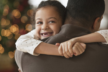 Father hugging daughter at Christmas