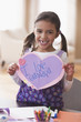 Mixed race girl holding Valentine for grandfather