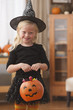 Caucasian girl in witch Halloween costume