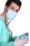 Doctor using stethoscope on globe