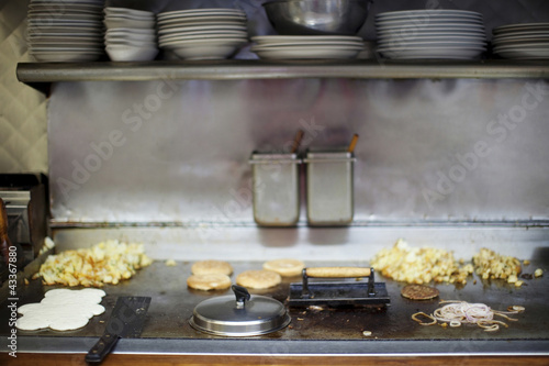 Breakfast cooking on diner griddle