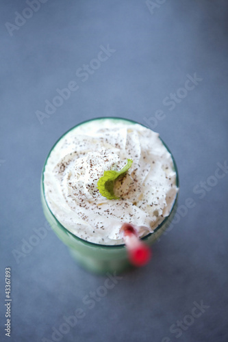Milkshake and straw in glass