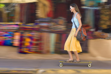 Caucasian woman skateboarding on sidewalk