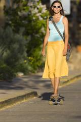 Caucasian woman skateboarding on street