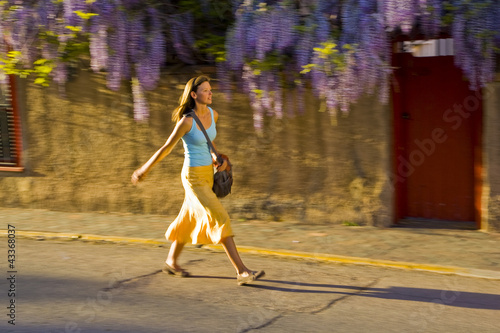 Caucasian woman walking on street