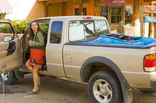 Hispanic woman getting out of truck