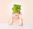 Fun portrait of a woman wearing a lettuce