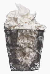 Wastepaper basket full of garbage