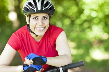 Hispanic woman riding mountain bike