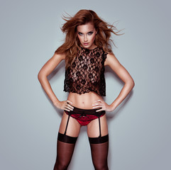 Provocative woman in lace and suspenders