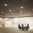 Business people working in hotel meeting room