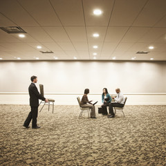 Business people working in hotel meeting room
